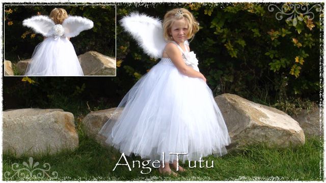 Girl wearing white angel tutu dress with white wings