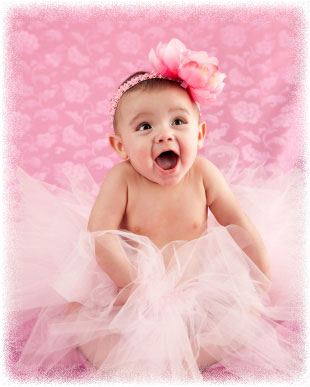 Baby wearing a tutu and smiling