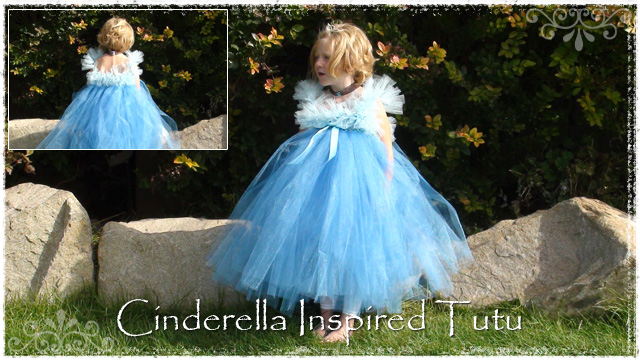 Girl wearing blue Cinderella tutu dress with blue ribbon