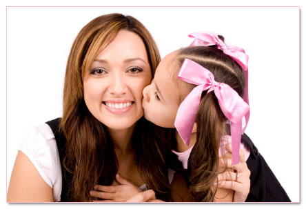 Mother with girl wearing pink hair bows