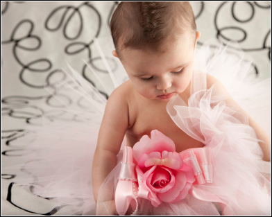 Adorable baby wearing a pink tutu skirt