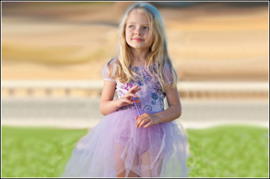 Young girl wearing a purple tutu dress