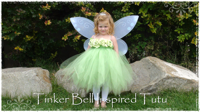 Girl wearing Tinker Bell tutu with white wings