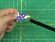 Sealing purple ribbon with lighter